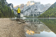 Italy, Braies Lake, man at the lakeside with mountains and forest in background - WPEF01341