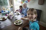 Portrait smiling granddaughter celebrating grandmother - HEROF14467