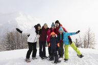Portrait enthusiastic, confident family snowshoeing - HEROF14482