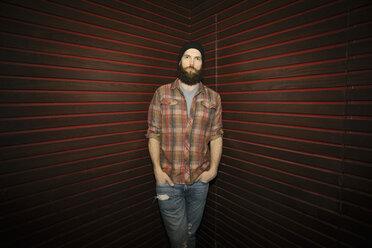 Portrait confident, cool male hipster millennial in nightclub - HEROF14506