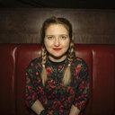 Portrait smiling, confident female millennial in nightclub - HEROF14533