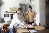 Teenage daughters serving cake to mother - HEROF14680