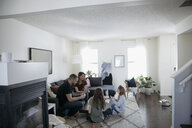 Family playing card game in living room - HEROF14836