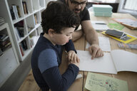 Father and son drawing robot in notepad - HEROF14842