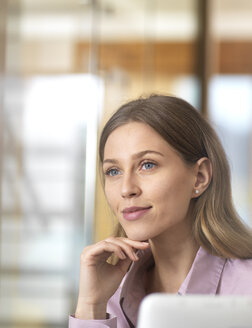 Confident businesswoman in office thinking - ABRF00263
