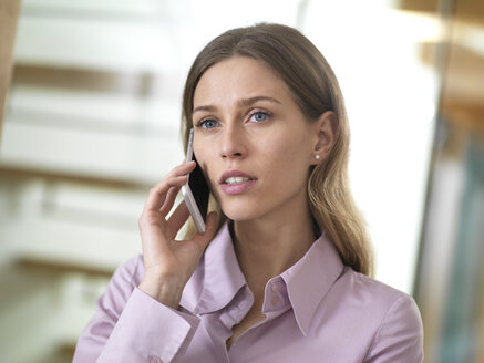 Portait of serious businesswoman on cell phone - ABRF00275