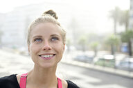 Portrait of smiling blond woman outdoors - ECPF00325