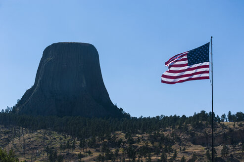 US flag before the Devils Tower National Monument, Wyoming, USA - RUNF01053
