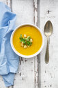 Bowl of sweet potato soup with mango, curcuma and coconut milk, croutons and basil - LVF07735