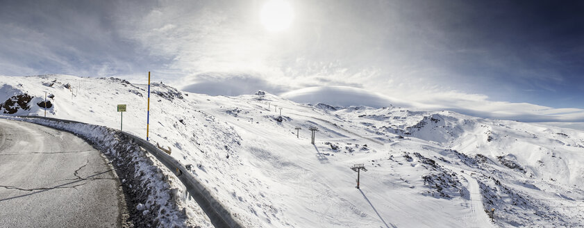 Spain, Andalusia, Granada. Panoramic view of ski resort of Sierra Nevada in winter, full of snow, with a sky of beautiful clouds. Travel and sports concepts. - JSMF00800