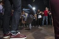 Crowd cheering and watching dancers in nightclub - HEROF14883
