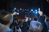 Crowd cheering for DJ on stage at nightclub - HEROF14889