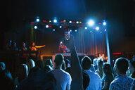 Crowd watching DJ on stage in nightclub - HEROF14934