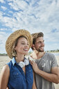 Happy young couple on the beach - RORF01690