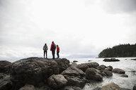 Family on rocks enjoying rugged ocean view - HEROF15139