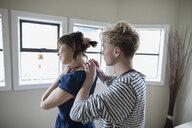 Boyfriend putting necklace on girlfriend - HEROF15235