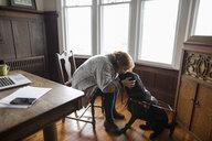 Affectionate woman kissing seeing eye dog - HEROF15241