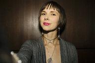 Confident, cool female millennial taking selfie - HEROF15292