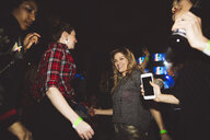 Happy millennial women friends dancing at nightclub - HEROF15679