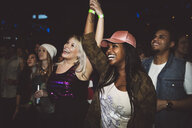 Happy, exuberant millennial women friends dancing at music concert in nightclub - HEROF15682