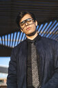 Portrait of fashionable young businessman wearing glasses and tie - AFVF02316