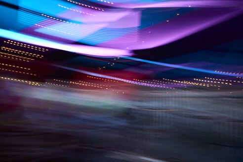 Colorful party lights in movement as a result of a long exposure shot - IGGF00745