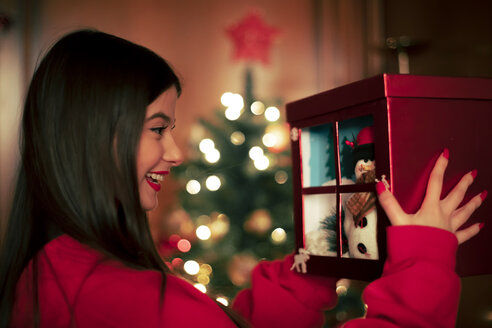 Happy teenage girl with Christmas present - ACPF00426
