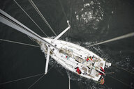 Overhead view sailing team training on sailboat - HEROF15865