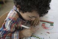 Preschool boy writing letters with marker - HEROF15976