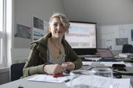 Portrait confident female city planner working in office - HEROF16036