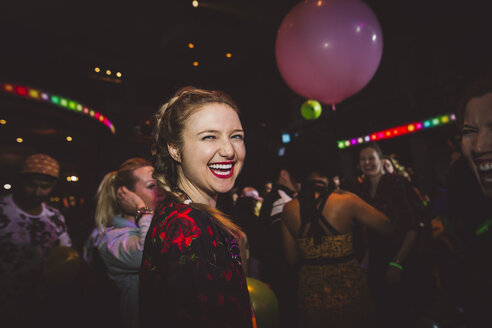Portrait confident, enthusiastic female millennial partying in nightclub - HEROF16045