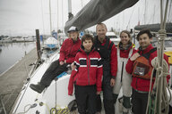 Portrait confident sailing team on sailboat in harbor - HEROF16096