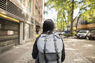 Young woman with backpack on urban street - HEROF16267