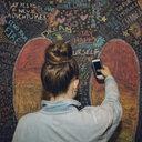 Tween girl with hair bun taking selfie along wall with chalk wings - HEROF16366