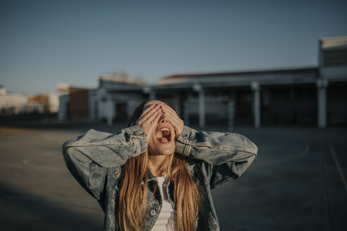 Pozoblanco, Cordoba, Spain, Urban girl covers her eyes, youth culture - DMGF00030