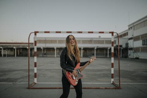 Pozoblanco, Cordoba, Spain, Rocker girl with a red guitar, musician - DMGF00054