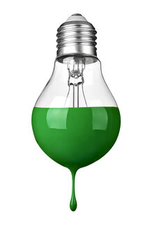 Close up of a green colored light bulb on white background, sustainability concept - RAMF00082