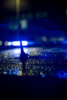 Spain, Madrid, rain falling on a police car at night - OCMF00254