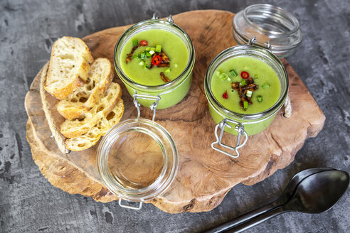 Two glasses of pea soup with fried tofu, red chili pepper and spring onions - SARF04088