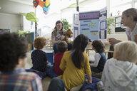 Preschool students watching tween girl giving diabetes presentation in classroom - HEROF17238