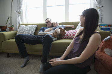 Young family relaxing in living room - HEROF17769