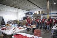 Christmas volunteers meeting in warehouse - HEROF17874
