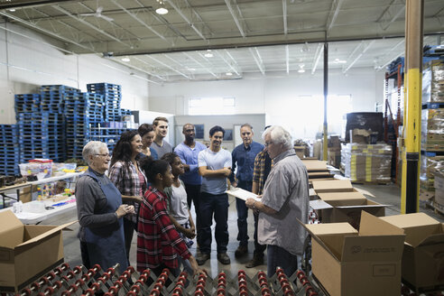 Community volunteers meeting in warehouse - HEROF18147