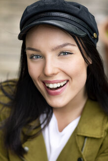 Portrait of a young woman with cap, laughing - PESF01256