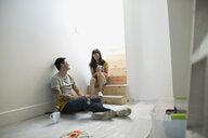 Couple enjoying coffee break from home improvement project - HEROF18511