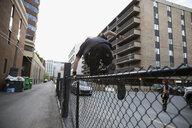 Man jumping urban fence - HEROF18919