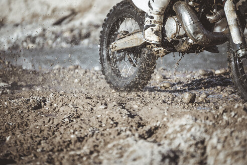 Close-up motocross wheel with water and mud - OCMF00259