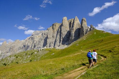 Italy, South Tyrol, Sella group, hikers walking up Passo di Sella - LBF02357