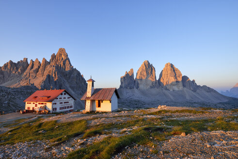 Chapel and Refugio Antonio Locatelli  with the famous Tre Cime di Lavaredo and Mount Paterno at sunrise, Trentino-Alto Adige, Italy - RUEF02119