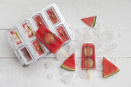 Homemade watermelon cucumber ice lollies on white ground - GWF05841
